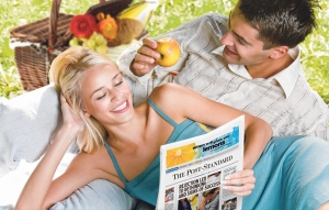 Couple reading The Post-Standard